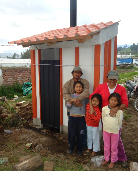 A family in Chambo with its new Dry Toilet
